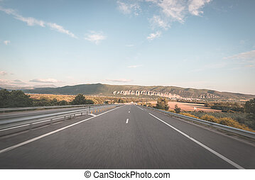 Paved two lane road crossing mountains and forest Panoramic...