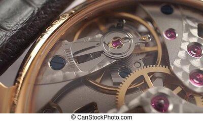 Macro dolly video of wrist watch mechanism clip