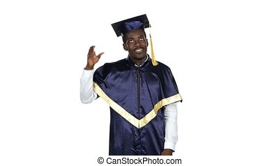 Graduate picks up square academic cap and throws. - Graduate...
