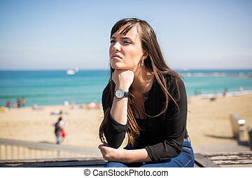 Deep thought - A photo of young, beautiful woman sitting on...