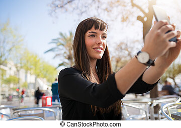Woman taking herself a photo by the mobile - A photo of...