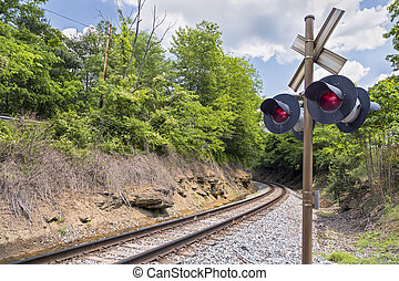 Curve and Crossing Signal - Railroad tracks round a curve...