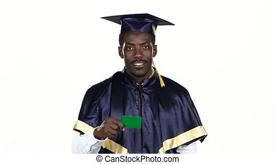 Graduate holding a green card. White. Close up - Graduate...