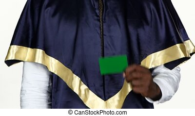 Graduate holds a green card White Close up - Graduate raises...