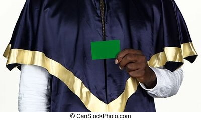 Student holding a green card and shows the thumb. White....