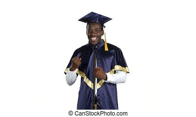 Graduate rejoices and dancing White - Graduate smiling and...