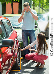 Unhappy Couple With Wheellock - Woman Looking At Man Calling...