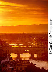Gold sunset at bridge ponte vecchio in florence old town on...
