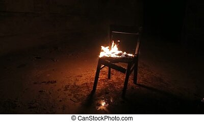 Chair on fire in an abandoned building