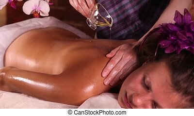 Back massage at health spa - Young Caucasian woman relaxes...