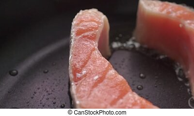 Macro dolly video of frizzling salmon steak clip