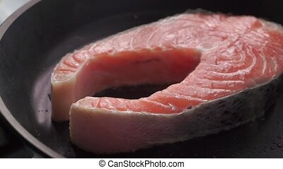 Close up dolly shot of frying salmon steak