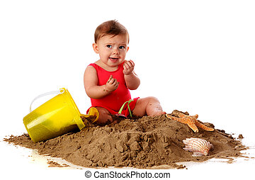 This Isnt Tasty - A baby girl with sand toys and shells...
