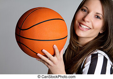 Basketball Referee Girl - Smiling girl referee holding...