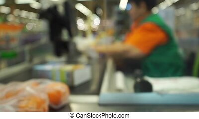 Supermarket checkout bokeh slow motion video - Supermarket...