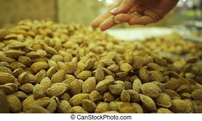 Unshelled almonds in a beautiful woman hand