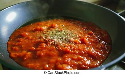 Making tomato and sour cream sauce on a frying pan clip