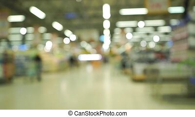 Supermarket bokeh lights. Dolly shot clip