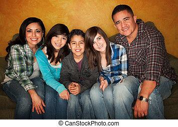 Hispanic family - Attractive Hispanic Family Sitting on a...
