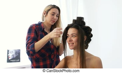 A young girl in the beauty salon make hairstyle