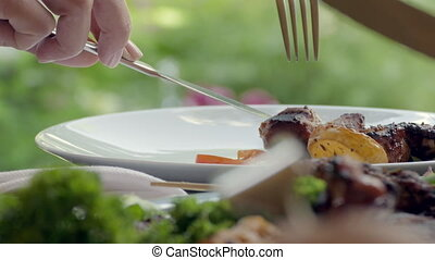 Woman Hands Putting Beef On The Plate At Restaurant,Close Up