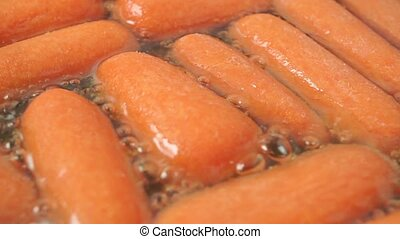 Roasting small carrots macro shot