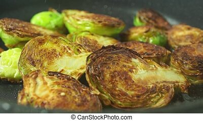 Frying Brussels sprouts macro shot clip