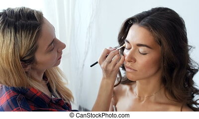 A young girl in a beauty salon make-up