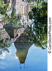 Beautiful Vajdahunyad castle is reflected in the water of...