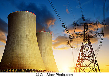 Nuclear power plant with high voltage tower at sunset