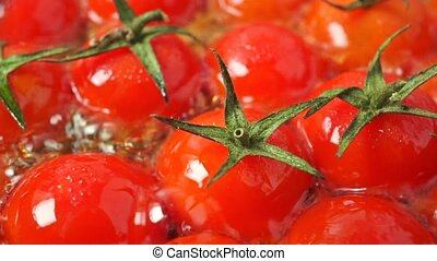 Roasting cherry tomatoes with leaves macro shot clip