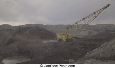 A dragline excavator working on development of open fields....
