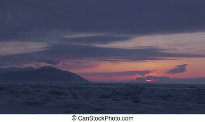 Sunset on a background of Holy Nose Peninsula Time Lapse -...
