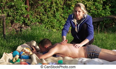 Massage on nature of man - Girl does massage to man in...