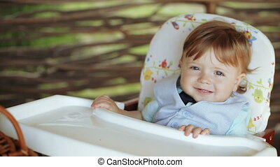 Naughty child at table - Naughty child on nature of table to...