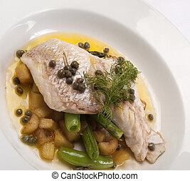 Fish Dish - A restaurant meal of fish and vegetables is a...