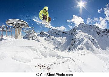 Ski rider jumping on mountains. Extreme ski freeride sport....