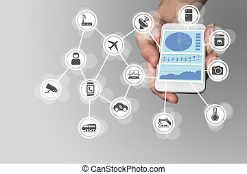 Hand with smartphone and IOT - Hand holding modern smart...
