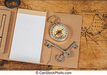 Compass with note book on old map vintage process style