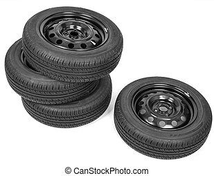 Stack of four wheel new black tyres, isolated on white...