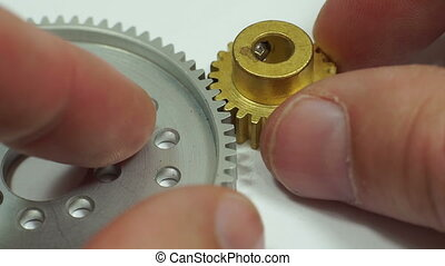 Spur Gear Pinion Hub Meshing Macro - Close up shot of an...
