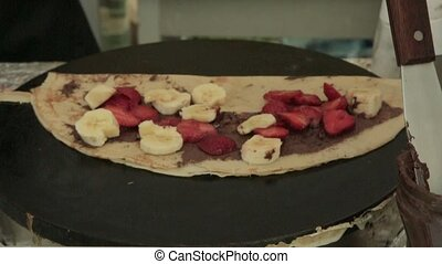 fresh pancake with fruits and chocolate syrup