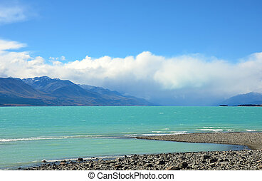 Lake Pukaki, New Zealand - Spectacular turquoise waters of...