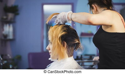 A radical change of hair color Attractive blonde woman in a...