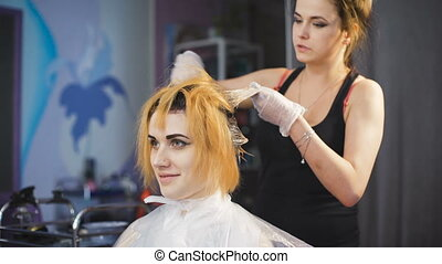 Professional hair color in the beauty studio. Beautiful girl...