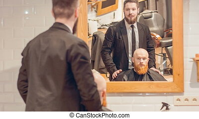 Professional barber working in the barbershop - What do you...
