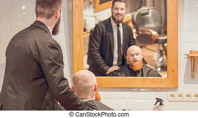 Professional barber working in the barbershop - Do...