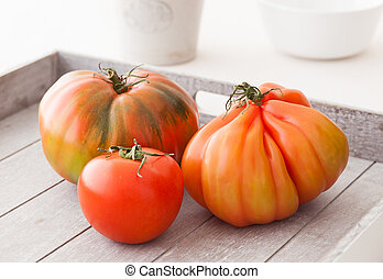 Organic tomatoes - Three different organic tomatoes from...