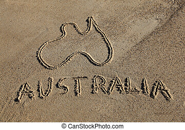 Australia Map and word drawn in the sand at the beach....