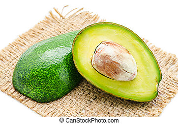 Fresh avocado fruits cit in half. - Fresh avocado fruits cit...